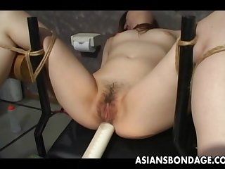 Asian slave tied up and toy fucked..